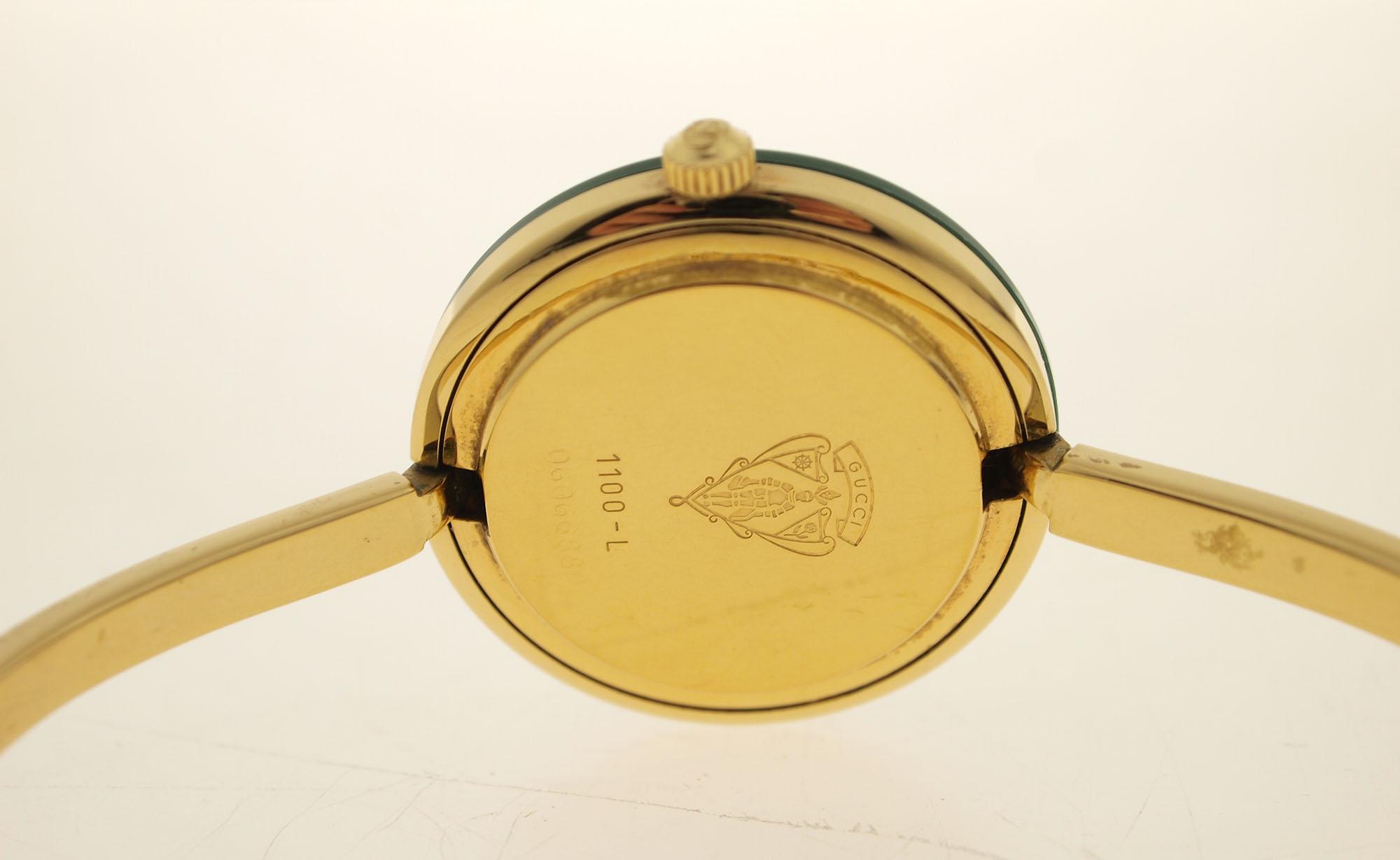 gucci designer spangenuhr mit 12 wechselbaren l netten vergoldet mit box ebay. Black Bedroom Furniture Sets. Home Design Ideas